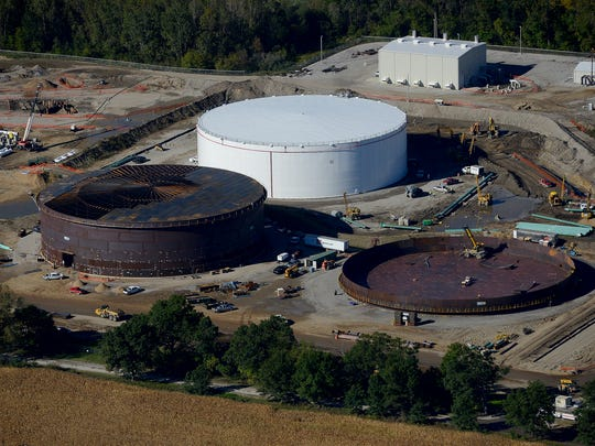 An close up of three new oil storage tanks in different