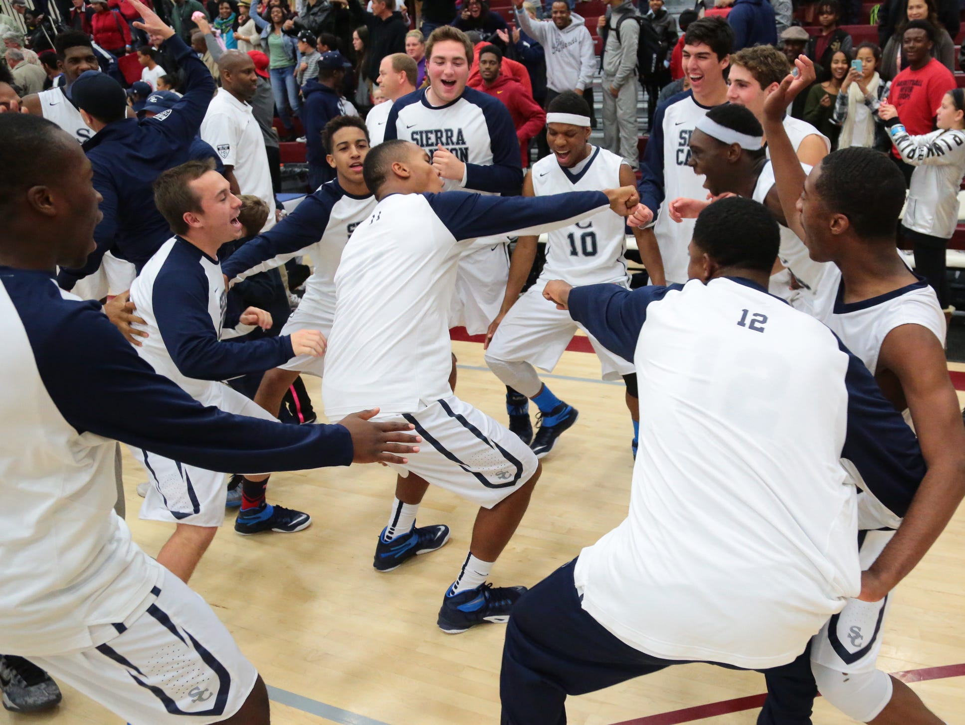 Sierra Canyon players celebrate their last-second win over Pebblebrook during the Open Division championship game of the 2014 MaxPreps Holiday Classic.