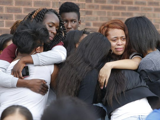 Classmates and friends of Amy Inita Joyner-Francis console each at Howard High School of Technology in Wilmington on April 25. A court hearing was held Monday in the student's death.