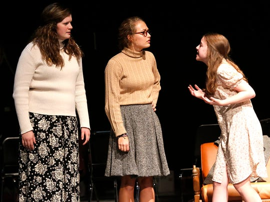 "St. Mary's Springs Academy students Mikaela Hanrahan, Anja Ozols and Meagan Haupt act out a scene for the upcoming play ""The Diary of Anne Frank"" at the North Fond du Lac PAC. The play will run Nov. 18, 19 and 20."