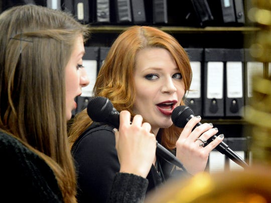 """Sisters Anna Pavoncello of Springettsbury Township, left, and Christy Weist of Wrightsville sing together during a rehearsal of The Unforgettable Big Band at First Presbyterian Church in York City Tuesday, April 18, 2017. The band is one of several playing the """"Big Swing Thing"""" at the Valencia Ballroom April 27-29. Friday's kickoff dance runs from 7:00 p.m.-12:30 a.m. (doors open at 6:30), and Saturday's show runs with two sessions featuring three bands each: a 9:00 a.m. and until 4:30 p.m., and a session from 4:30 p.m. through midnight. A full day pass includes admission to both sessions. The Unforgettable Big Band plays Saturday night. Bill Kalina photo"""