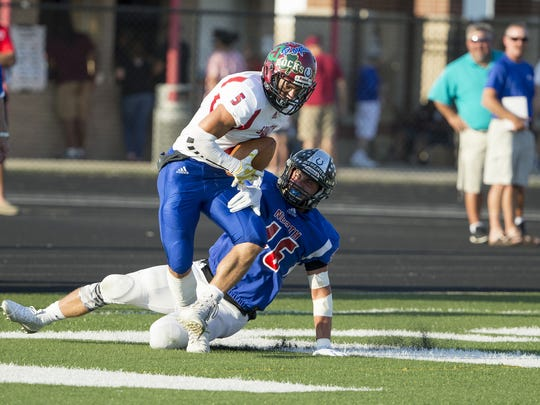 South's Wide receiver Ben Stevens (5) scores over North's defensive back Mason Kaletha (16) during the IFCA North-South All-Star game at North Central High School on Friday, July 13, 2018. Stevens was the first to score a touchdown during the game.