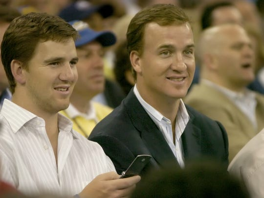 Eli and Peyton Manning watch LSU and UCLA in their