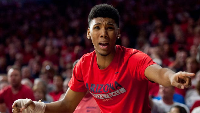 Arizona Wildcats guard Allonzo Trier (11) reacts to a call from the bench during the second half against the Oregon State Beavers at McKale Center. Arizona won 80-63.