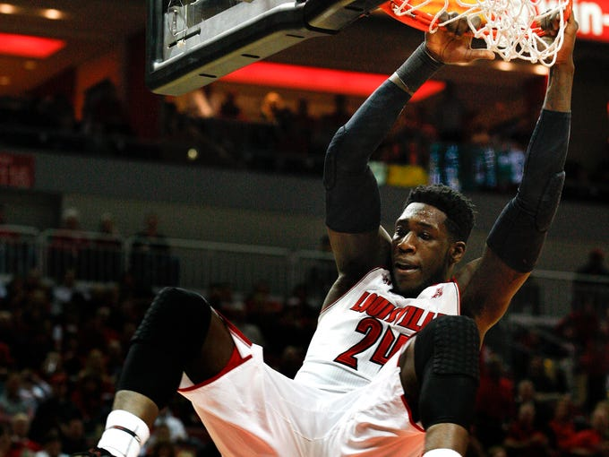 U of L's Montrezl Harrell, #24, dunks against USF during their game at the KFC Yum! Center.     Feb. 18, 2014