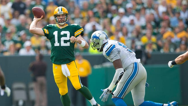 Green Bay Packers quarterback Aaron Rodgers (12) throws a pass during the first quarter against the Detroit Lions at Lambeau Field.