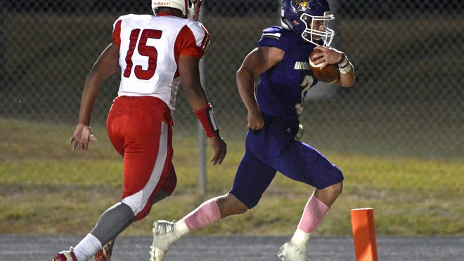 Booneville's Randon Ray, right, steps into the end zone just ahead of Atkins' Michael Dunagan for a first quarter rushing touchdown on Friday, Oct. 23 in Booneville.