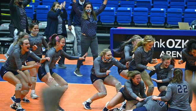 Greenwood volleyball coach Jennifer Golden, top center, celebrates along with the team as they win the 5A state championship in the Hot Springs Convention Center on Saturday. Greenwood defeated Jonesboro 3-0.