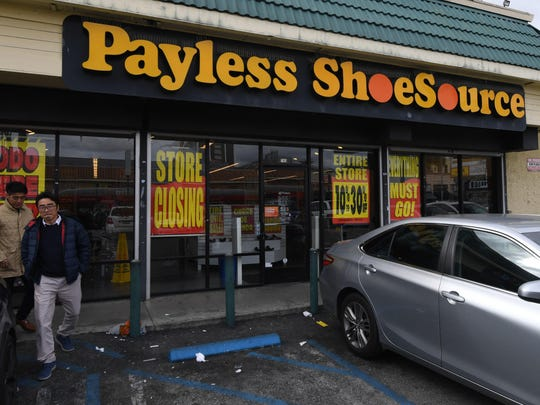 Customers leave a Payless Shoes store in Los Angeles,