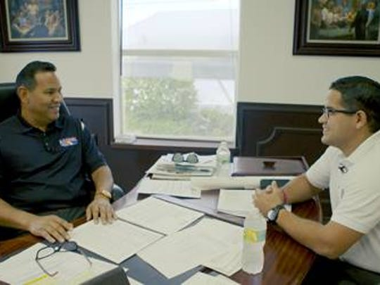 Luis Garcia meets with a Sweetwater city commissioner.