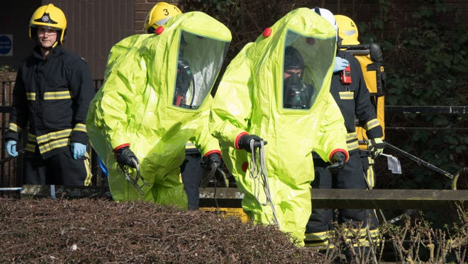 Specialist officers in protective suits prepare to secure the police forensic tent that had been blown over by the wind and is covering the bench where Sergei Skripal was found critically with his daughter on March 4 and were taken to hospital sparking a major incident, in Salisbury on March 8, 2018 in Wiltshire, England.