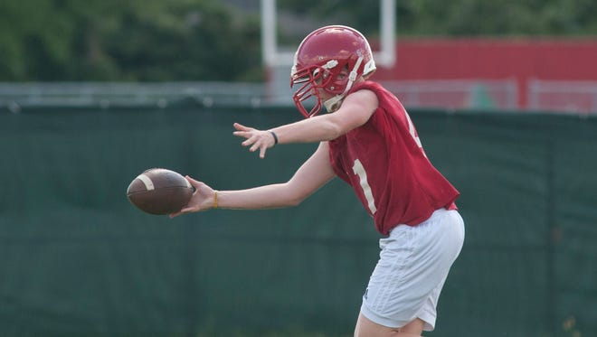 Jeffersonville kicker Alex Macaluso prepares to connect with the football during practice on Thursday, Aug. 11, 2016.