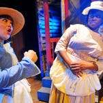 """Evita Ali Clowney of Palm Bay plays Sophia, and Precious Evans of Melbourne is Celie in """"The Color Purple."""""""
