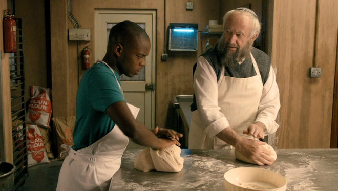 """Jerome Holder and Jonathan Pryce star in """"Dough."""" The film opens Friday at the Small Star Art House in York City."""