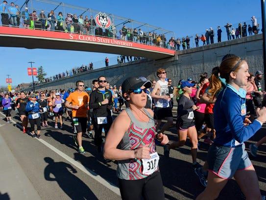 Jodi Gertken, Sartell, starts the Earth Day Half Marathon