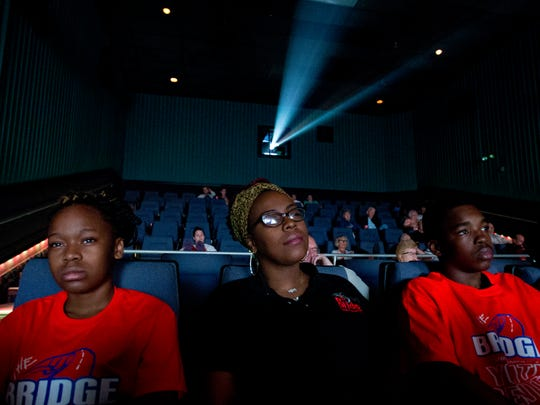 From left, Ni'Jaee Battle, Katrina Shanks and Willie Green watch the movie Selma at the Regal Cinemas at the Bell Tower Shops.
