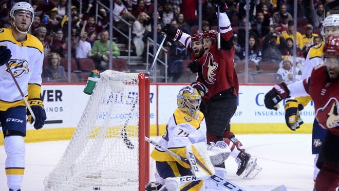 Jan 4, 2018; Glendale, AZ, USA; Nashville Predators goalie Juuse Saros (74) reacts after giving up a goal to Arizona Coyotes left wing Anthony Duclair (10) during the second period at Gila River Arena. Mandatory Credit: Matt Kartozian-USA TODAY Sports