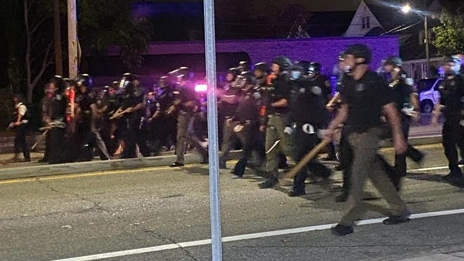 Police face protesters on Elmwood Avenue on Wednesday night.