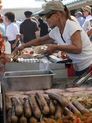 Jackie Moonshower prepares food for guest to Oktoberfest