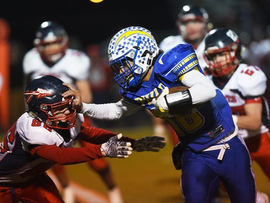 Philo's Isaac Gill brushes off an Indian Valley defender during the playoffs. Gill and teammate Lane Deal each received All-Ohio second-team accolades for their seasons.