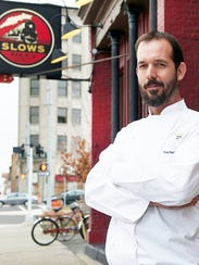 Slows Bar BQ chef and co-owner Brian Perrone poses