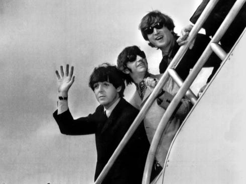 The Beatles - Paul McCartney, left, Ringo Starr,  John Lennon and George Harrison - will receive the Grammys lifetime achievement award. Both Starr and McCartney will perform, as well.