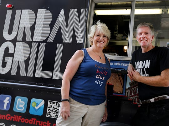Betsy Eicher, left, with her brother-in-law Randy Reichelderfer at their Urban Grill food truck. Urban Grill also has a sit-down restaurant on Main Street in Newtown.
