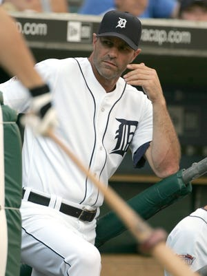 Kirk Gibson looks on from the dugout steps during a game against the  Minnesota Twins on July 22, 2005.