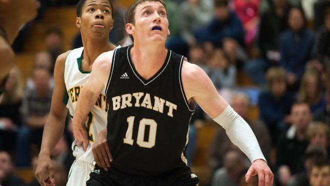 Bryant's Joe O'Shea (10) battles for position with Catamounts guard Trae Bell-Haynes (2) during the men's basketball game between the Bryant Bulldogs and the Vermont Catamounts at Patrick Gym on Wednesday night November 26, 2014 in Burlington, Vermont. (BRIAN JENKINS, for the Free Press)