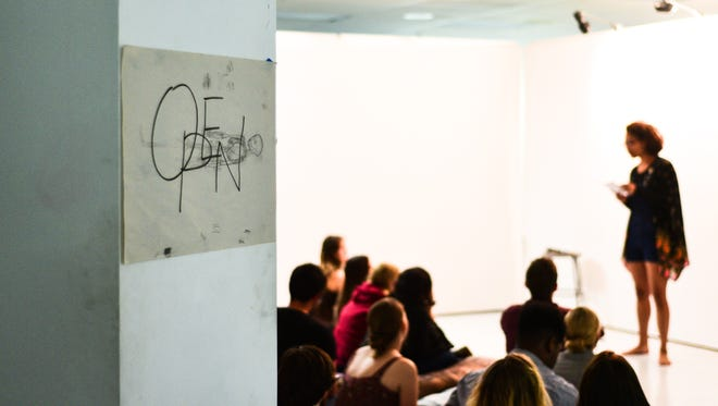 """Open, which describes itself as, """"a performance based show exhibiting art in the form of reading, writing, spoken word, and/or performance"""" held its third show at the Phyllis Straus Gallery on Friday, March 30th."""