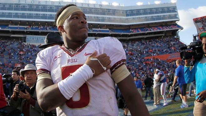 Florida State quarterback Jameis Winston (5) walks off the field last Saturday at Ben Hill Griffin Stadium after the Seminoles beat Florida.