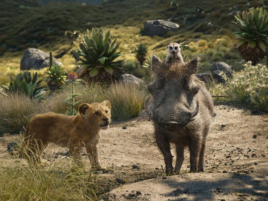 "From left, young Simba, voiced by JD McCrary, Timon, voiced by Billy Eichner, and Pumbaa, voiced by Seth Rogen, in a scene from ""The Lion King."" The movie is playing at Regal West Manchester, Frank Theatres Queensgate Stadium 13 and R/C Hanover Movies."