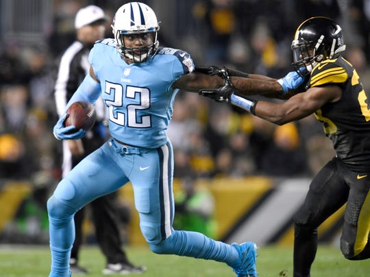 Titans running back Derrick Henry (22) stiff arms Steelers safety Sean Davis (28) during the second quarter at Heinz Field Thursday, Nov. 16, 2017 in Pittsburgh, Pa.