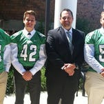 Novi's football fortunes for coach Jeff Burnside will rest on (from left) Cooper Smith, Brent George and Dyland Haggard.