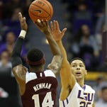Mississippi State freshman Malik Newman  shoots as LSU  freshman  Ben Simmons  defends at the Pete Maravich Assembly Center.