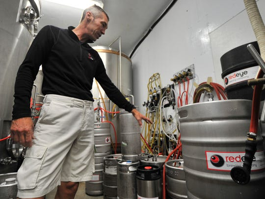 Brewmater Kevin Eichelberger, shows some kegs store