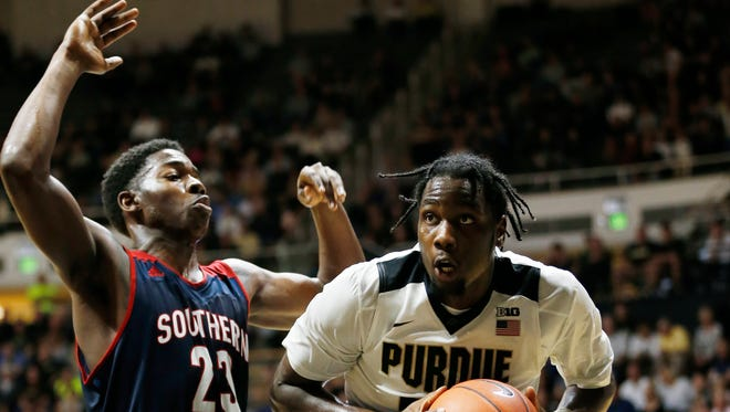 Caleb Swanigan works the baseline against Dayjar Dickson of Southern Indiana Tuesday, November 1, 2016, at Mackey Arena. Purdue defeated Southern Indiana 85-63.