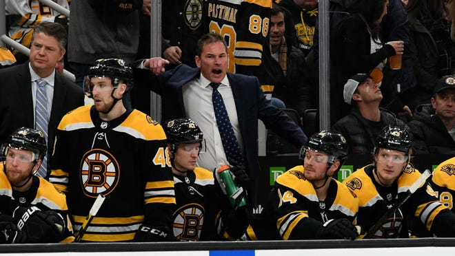 Bruins coach Bruce Cassidy reacts to a call by an official during a game last fall. The Bruins are to open training camp on Monday with the season set to resume on July 24.