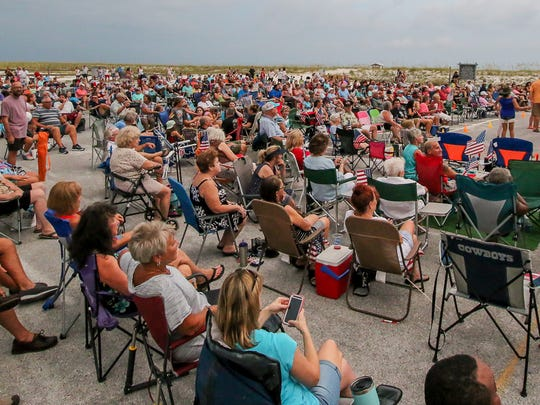 Hundreds of people enjoy music during the the weekly Tunes by the Dunes. This week features Sheandtheits Band.