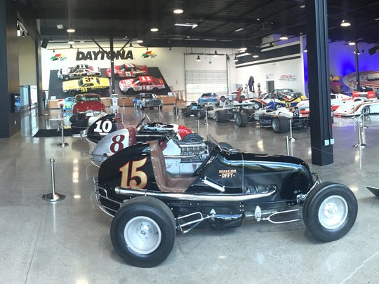 A display of open wheel race cars at the World of Speed museum.