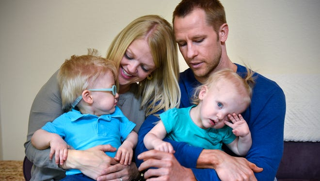 Alyssa and Scott Gullickson hold their twins Evan and Brielle on Wednesday, June 1, 2016, at their home near St. Joseph. Evan and Brielle were born 17 days apart.