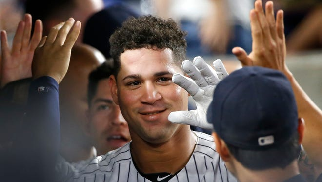 Teammates celebrate with New York Yankees' Gary Sanchez, center, and Jacoby Ellsbury, left, after Sanchez hit a fifth-inning, two-run home run, scoring Ellsbury, in a baseball game against the Baltimore Orioles in New York, Friday, Aug. 26, 2016.