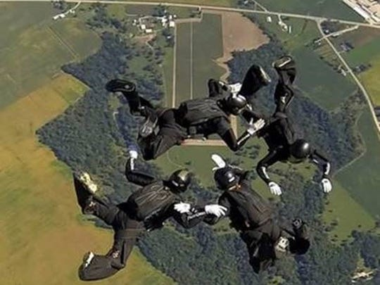 "Skydivers form a ""star"" formation at the U.S. Parachute"