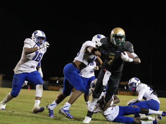 Lincoln running back Ricky Henrilus held off Godby defenders all night, rushing 38 times for 214 yards and four touchdowns in a 42-34 win.