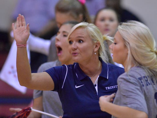 Trinity Coach Jessica Lassiter during a time out in their game with St. James in the Montgomery Area volleyball tournament at Trinity Presbyterian School on Tuesday, Oct. 21, 2014.