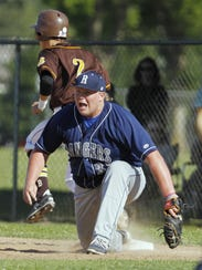 Redwood's Jace Chamberlin makes a scoop at first for