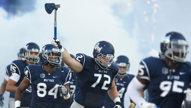 The Wolf Pack takes the field before its win over Buffalo earlier this season.