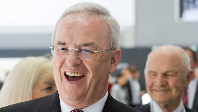 In this May 13, 2014 file picture, then-Volkswagen Group chairman Ferdinand Piech, right, and then-Volkswagen CEO Martin Winterkorn, front, arrive for the company's annual meeting in Hannover, Germany.