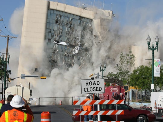 El Paso's old City Hall building falls after demolition charges are fired on April 14, 2014, to make way for Southwest University Park.