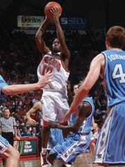 Andre Collins (10) of the Maryland Terrapins shoots against the North Carolina Tarheels during an ACC Conference basketball game at Cole Field House in College Park, Maryland in 2002.
